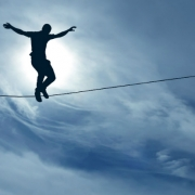 silhouette of man balancing on the rope concept of risk taking
