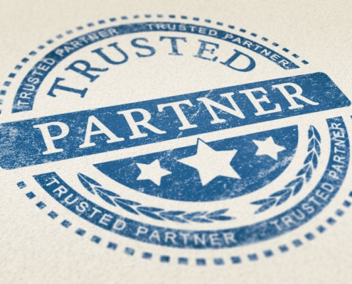 trusted partner mark imprinted on a paper texture. concept background for illustration of trust in partnership and business services.